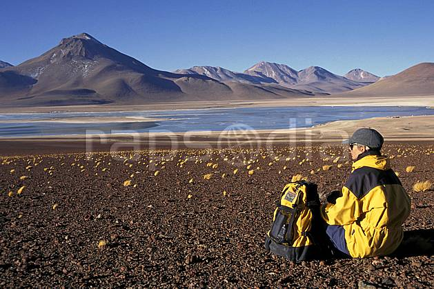 eb1226-27LE royalty free laguna verde, sud lipez, trekking, South America, Latin America, America, sport, leisure, action, aquatic sport, slide, blue sky, laguna, lagoon, rest, backpack, woman, lake, landscape, people, adventure trip (Bolivia).