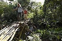 Passage d'une passerelle, village de Douguiha - Crossing a footbridge, village of Douguiha, ref eb072635GE